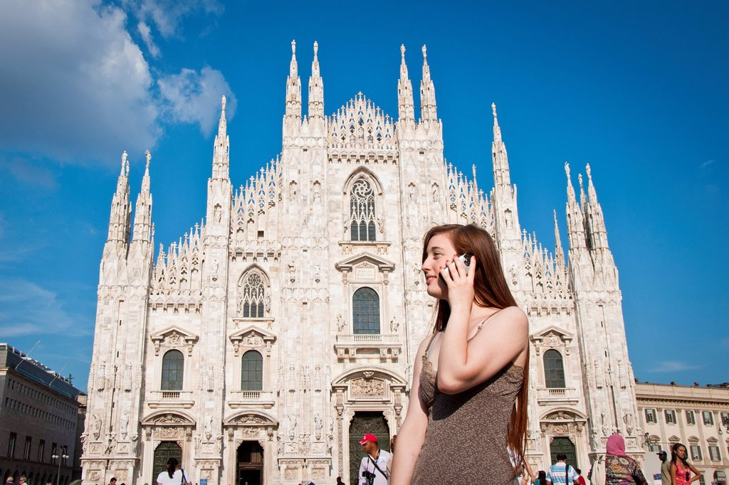 Stock Photo: 3153-854005 Italy, Lombardy, Milan, Duomo town square, woman with mobile