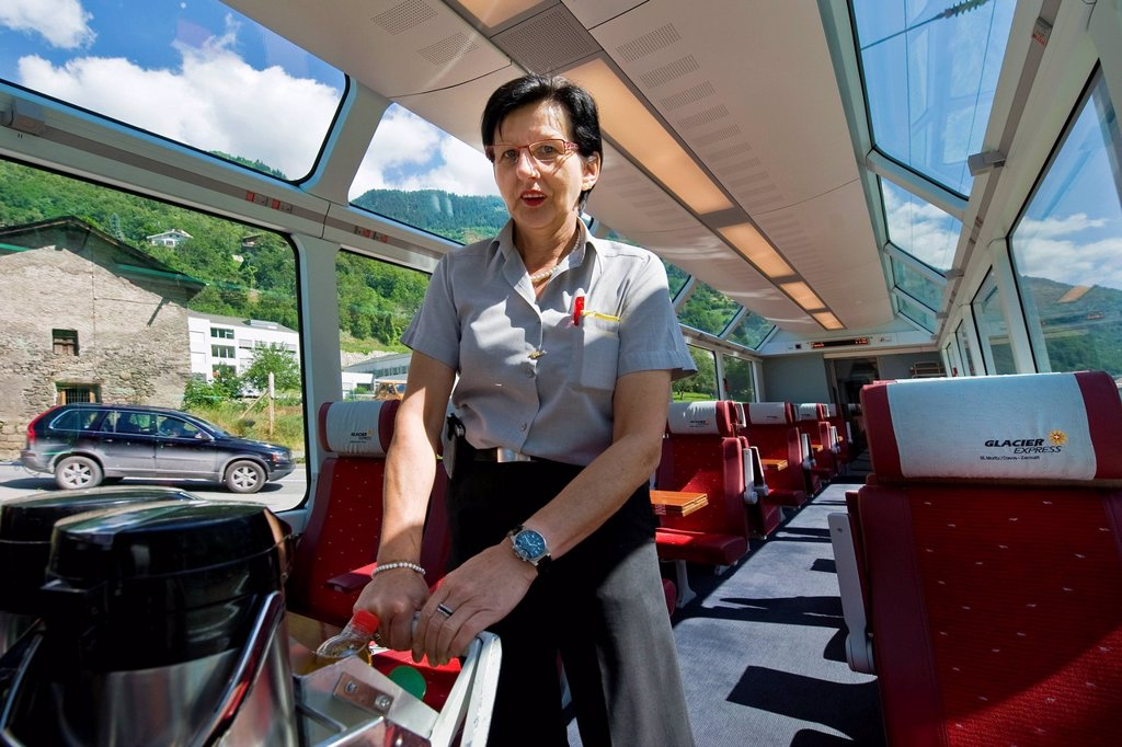 Switzerland, Canton Valais, Glacier express, train controller : Stock Photo