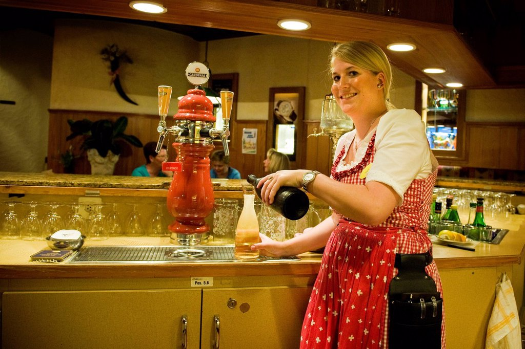 Stock Photo: 3153-857604 Switzerland, Canton Valais, Zermatt, waitress in traditional costume