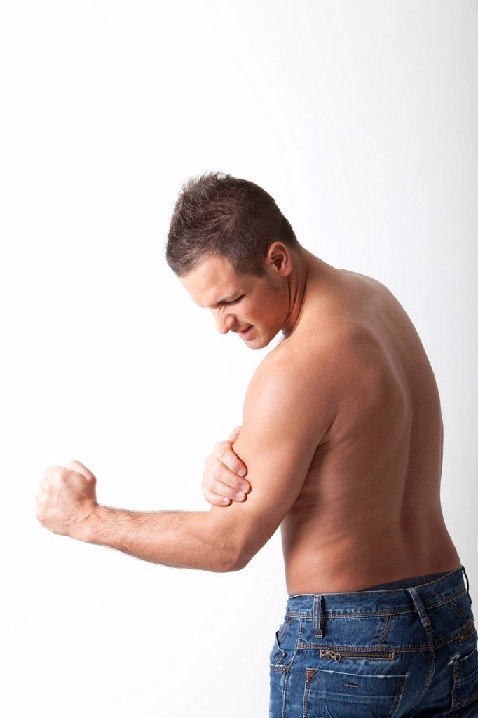 Stock Photo: 3153-858521 uomo con dolore al bicipite. man with pain in the biceps