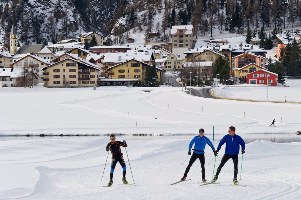 cross country skiing and village, silvaplana, switzerland : Stock Photo
