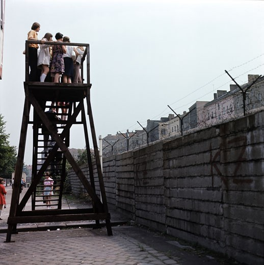 Tourists on an observation stand, Berlin Wall, Berlin, Germany : Stock Photo