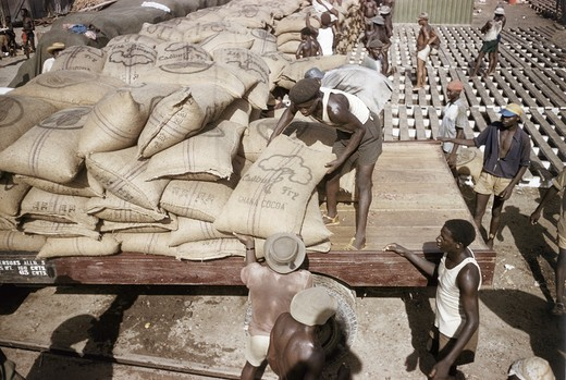 Stock Photo: 3803-446759 Ghana, Workers loading bags with cocoa for export