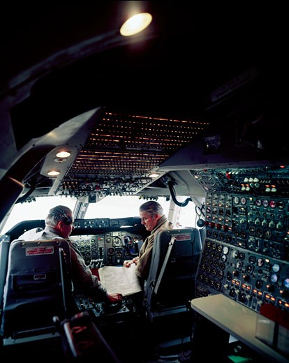 Stock Photo: 3807-319054 Rear view of two pilots in the cockpit of an airplane