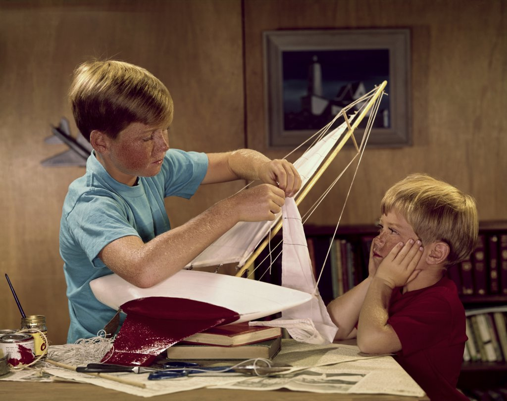 Stock Photo: 3811-361334C Two boys assembling a model of sailboat