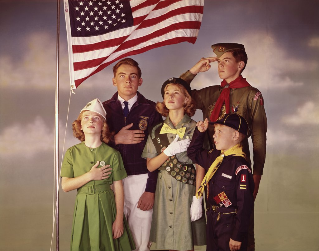 Stock Photo: 3811-362164 Scouts taking Pledge of Allegiance in front of an American flag