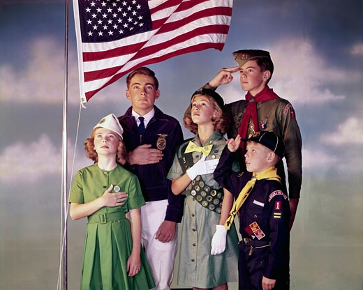 Stock Photo: 3811-362165 Scouts saluting the American flag