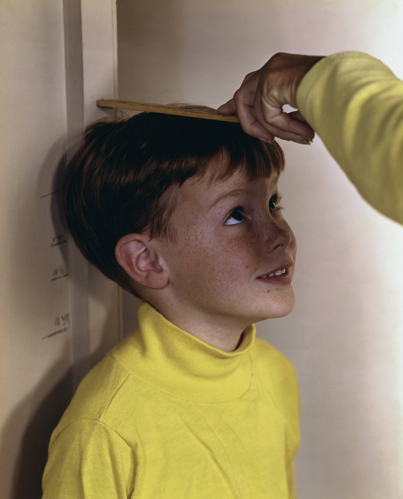 Stock Photo: 3811-362281 Boy being measured