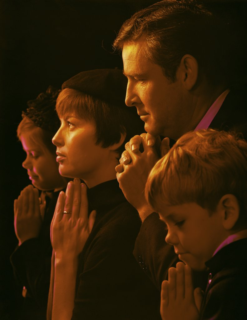 Stock Photo: 3811-362764 Family praying in a church