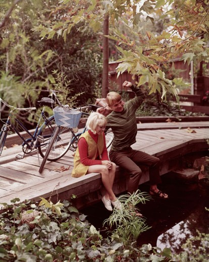 Stock Photo: 3811-362869 High angle view of a teenage couple sitting on a wooden bridge