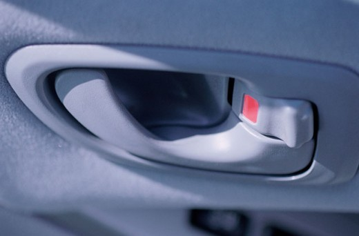 Close-up of the handle of a car door : Stock Photo