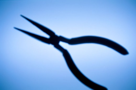 Silhouette of a pair of pliers : Stock Photo