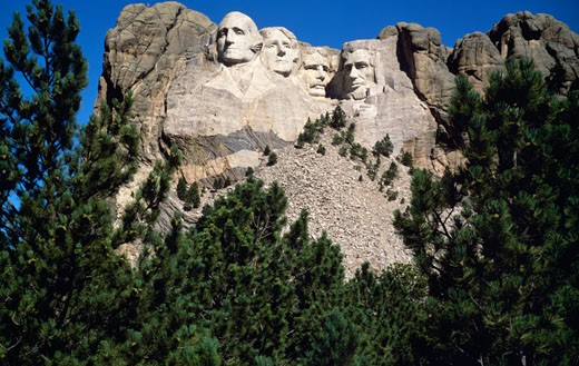 Stock Photo: 400-11795 USA, South Dakota, Rapid City, Mt Rushmore National Monument, Low angle view of heads of former US presidents carved on monument