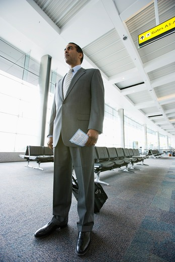 Businessman waiting at the airport : Stock Photo