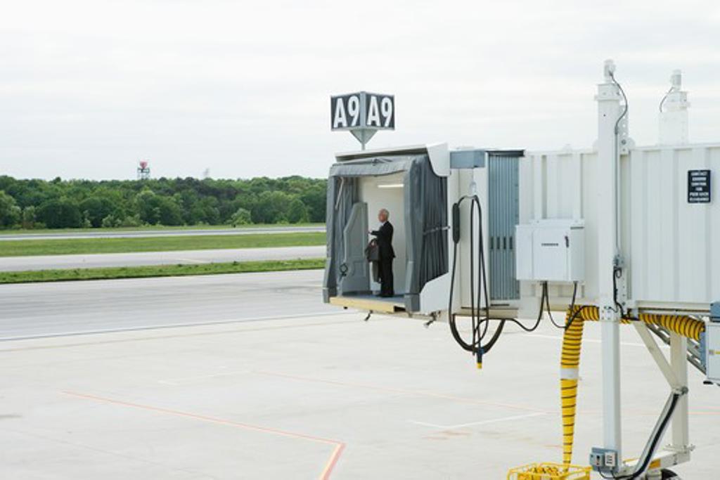 Man waiting at airport gate : Stock Photo