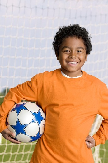 Stock Photo: 4001-1122B Boy holding a soccer ball