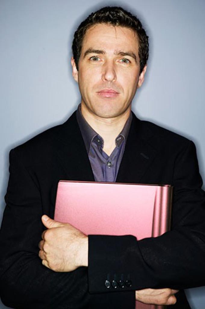 Stock Photo: 4001-283 Portrait of a businessman holding a laptop