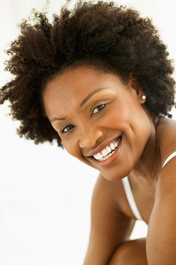Portrait of a young woman smiling : Stock Photo