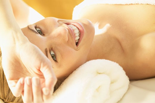 Stock Photo: 4001-435 Portrait of a young woman lying on a massage table and smiling
