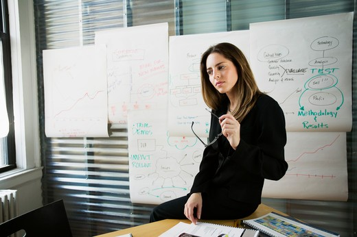 Stock Photo: 4001-850 Businesswoman contemplating a idea