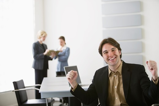 Stock Photo: 4001-860 Businessman cheering in an office