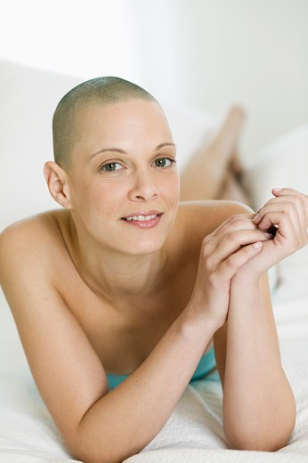 Stock Photo: 4001-934 Close-up of a young woman lying on the bed and smiling