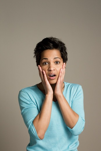 Stock Photo: 4001R-1184B Mid adult woman looking shocked
