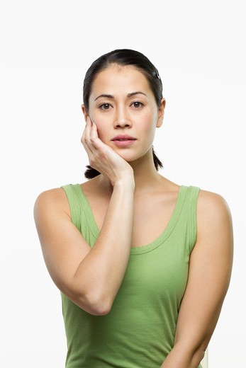 Stock Photo: 4001R-1258 Young woman thinking and looking sad