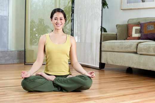 Stock Photo: 4001R-1382 Young woman doing yoga at home