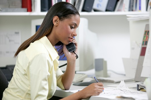 Businesswoman working in an office : Stock Photo