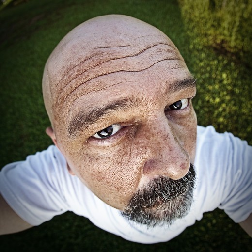 USA, Florida, Jacksonville, Jacksonville Beach, Portrait of mans distorted face : Stock Photo