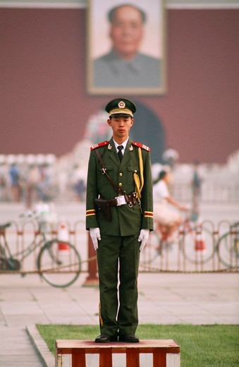 Chinese soldier standing on a platform in Tiananmen Square, Hall Of Supreme Harmony, Forbidden City, Beijing, China : Stock Photo