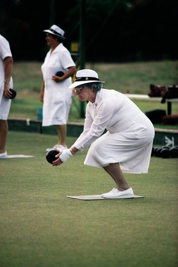 Stock Photo: 4009-1041 Woman playing bocce ball, Sydney, New South Wales, Australia
