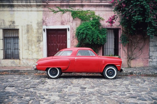 Stock Photo: 4009-351 Antique car on a cobblestone road, Buenos Aires, Argentina
