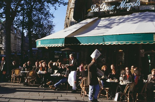 People at outdoor cafe, Les Deux Magots, Paris, Ile-de-France, France : Stock Photo