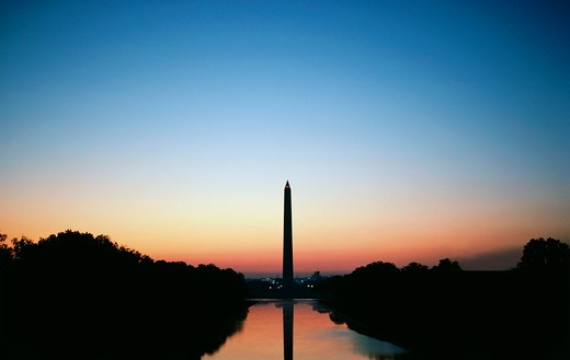 Stock Photo: 4009-707 Reflection of a monument on water, Washington Monument, Washington DC, USA