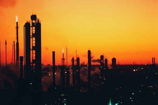 Stock Photo: 4009-840 Silhouette of an oil refinery at sunset, Texas, USA