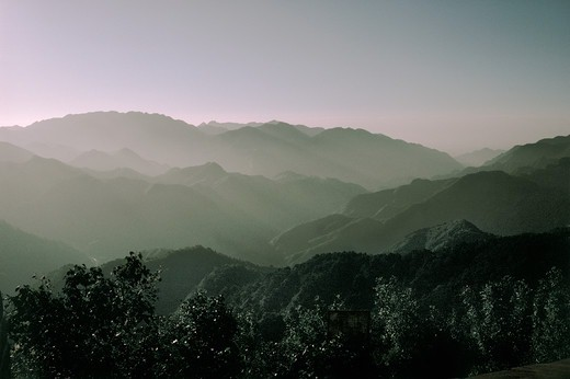 Stock Photo: 4009-971 Fog surrounding mountains at sunrise, China