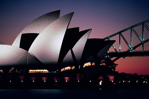Silhouette of an opera house and bridge, Sydney Opera House, Sydney Harbor Bridge, Sydney, New South Wales, Australia : Stock Photo