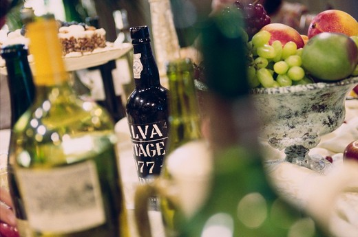 Stock Photo: 4009R-124 Close-up of wine bottles and food on a table