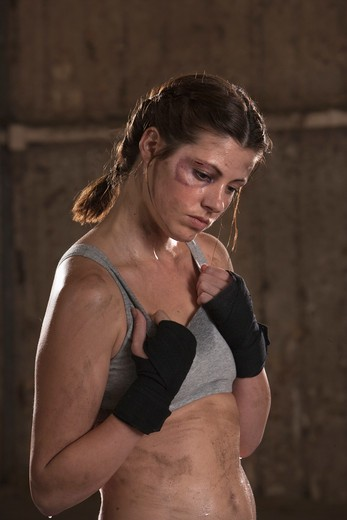 Stock Photo: 4010-108 Female boxer looking tired during practice