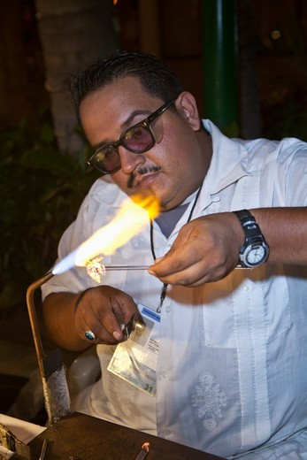 Stock Photo: 4011-940 Glass Blower creating tourist trinkets, Puerto Vallarta, Mexico