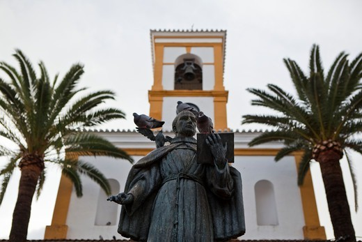 Bronze statue in front of a church on the island of Majorca, Spain : Stock Photo