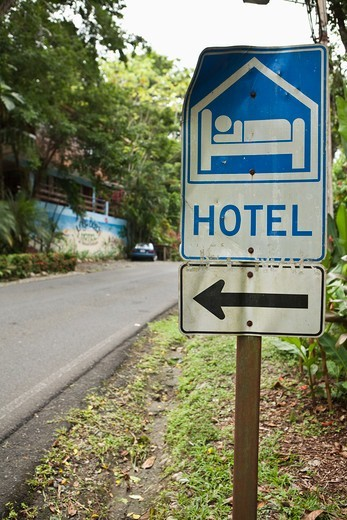 Hotel sign showing vehicles where to stop, Costa Rica : Stock Photo