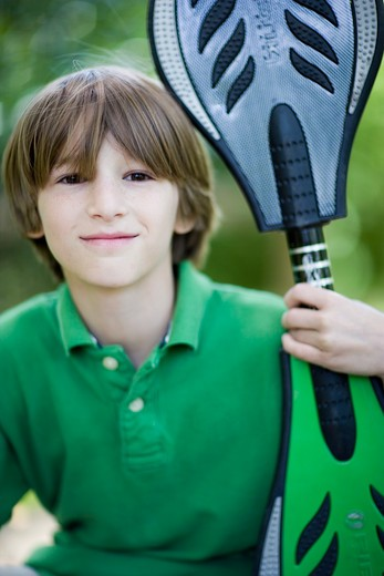 Stock Photo: 4011R-393C Boy holding a ripstik in a park, Texas, USA