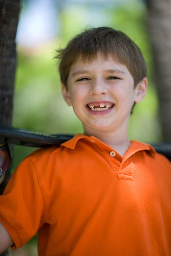 Stock Photo: 4011R-394D Boy holding a ripstik in a park, Texas, USA