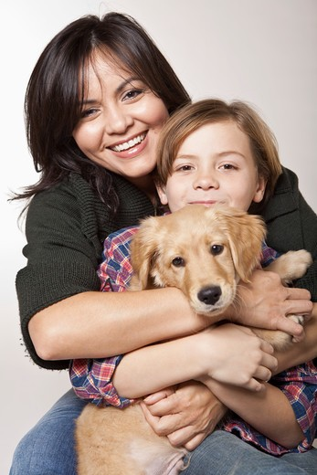 Stock Photo: 4011R-799 Studio portrait of woman with son holding puppy