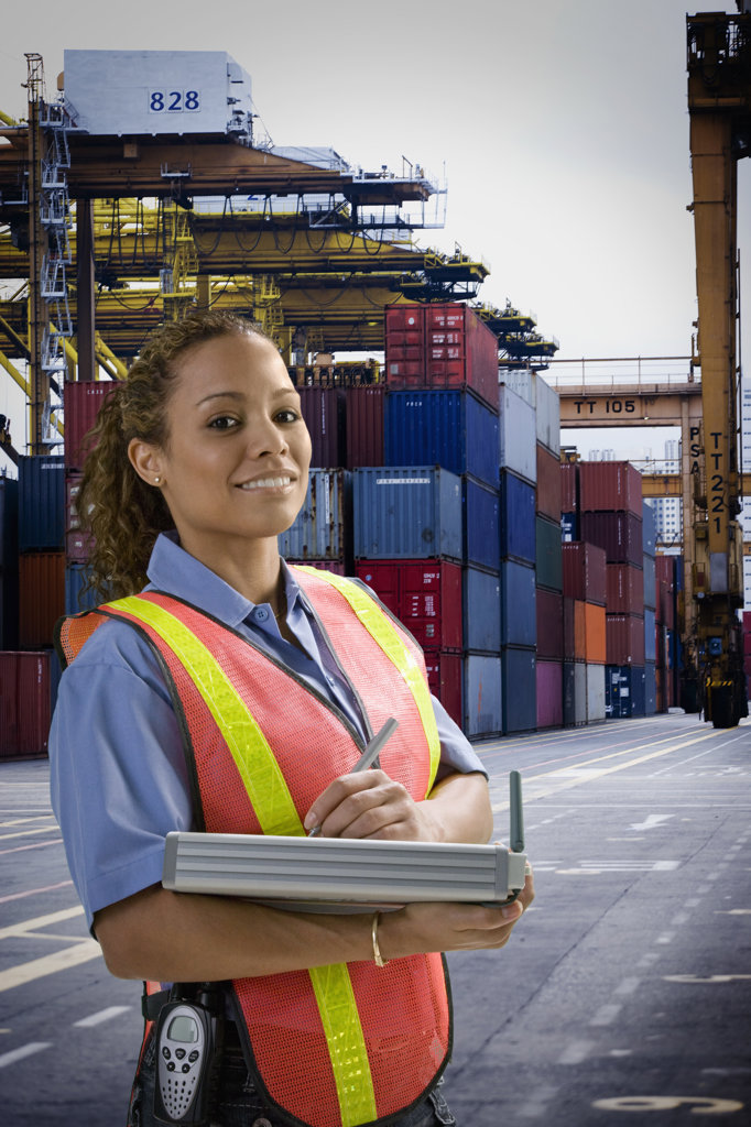 Stock Photo: 4013-103 Dock worker standing with a digital inventory pad at commercial dock