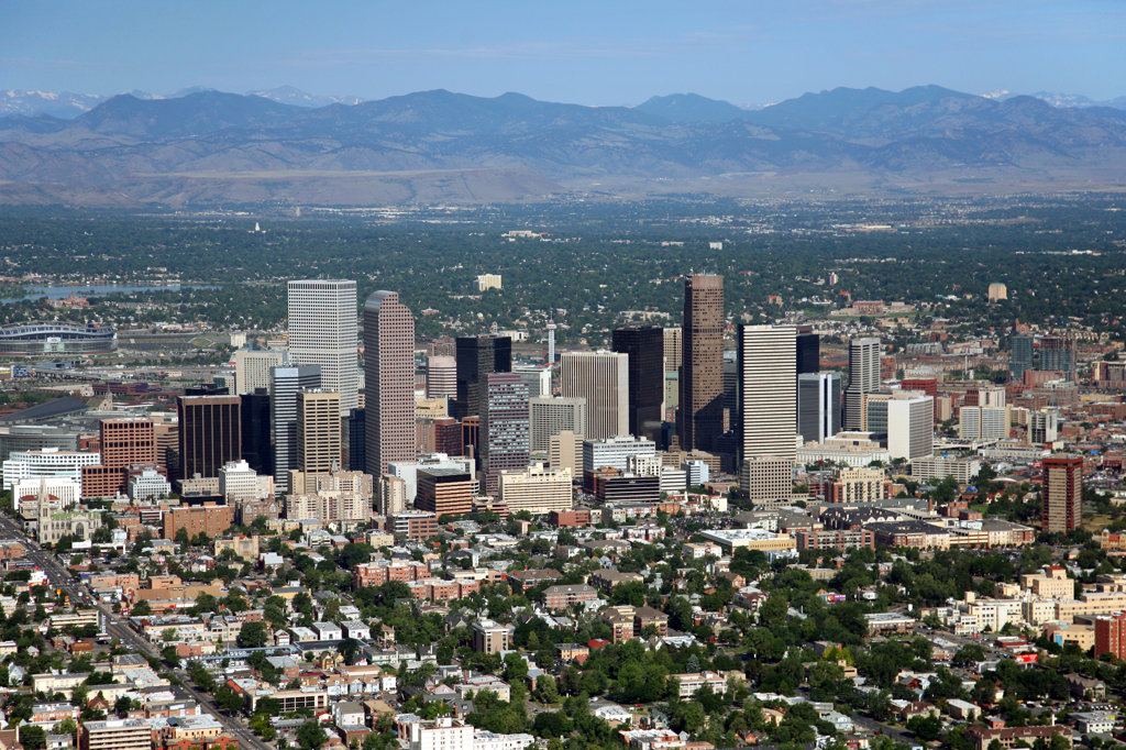 Aerial of Downtown Denver with the Uptown district in foreground and Rocky Mountains in background : Stock Photo