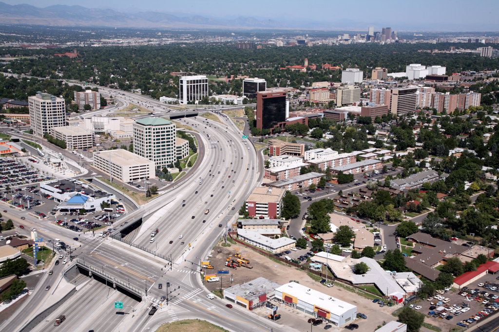 Aerial of Southeast Denver along Colorado Blvd with Cherry Creek and Downtown in background : Stock Photo